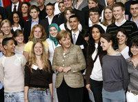 German Chancellor Merkel and immigrants' representatives at the Integration Summit (photo: AP)