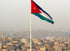 View of Ammann, Jordan, with a Palestinian national flag in the foreground (photo: AP)