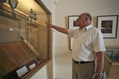 Simon Levi pointing to a Torah scroll in his Jewish Museum in Casablanca (photo: AP)