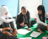 An NGO worker and young Indonesians (photo: Lyn Parker)