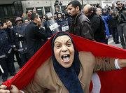 A Tunisian woman during a demonstration against Ben Ali (photo: AP)