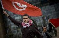 Young people demonstrating in Tunis (photo: AP)