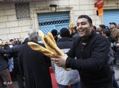 A Tunisian with fresh bread (photo: AP)