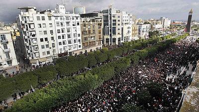 Demonstrators marching through Tunis (photo: AP)