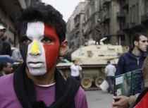 A young man demonstrating against the Mubarak regime in Cairo (photo: AP)