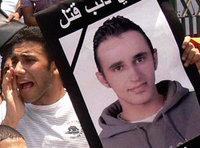 A young man takes part in a solidarity demonstration in memory of Khaled Said (photo: AP)