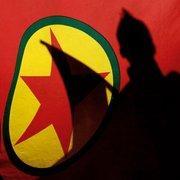 Shadows on the flag of the PKK (photo: AP)