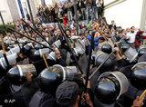 A police unit clashes with demonstrators in Cairo (photo: AP)