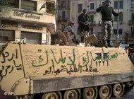 Armoured personnel carrier covered in graffiti in the centre of Cairo (photo: AP)