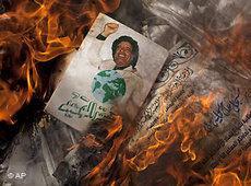Gadaffi's Green Book, burning (photo: AP)
