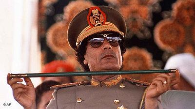 Muammar al-Gaddafi wearing a military uniform (photo: AP)