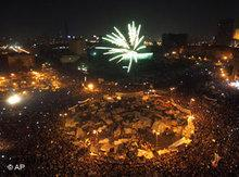 Egyptians celebrate on Tahrir Square after Mubarak's resignation (photo: Khalil Hamra/AP)