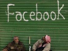 Faceboook graffiti on a store in Cairo (photo: dpa)