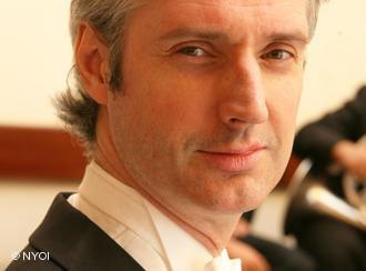 Conductor Paul MacAlindin (photo: NYOI)
