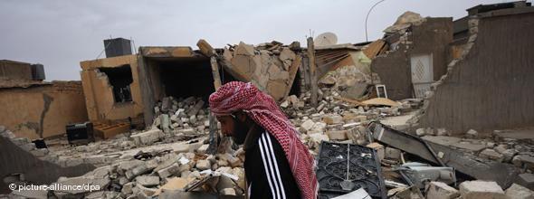 Destroyed building in Adjdabiya (photo: dpa)