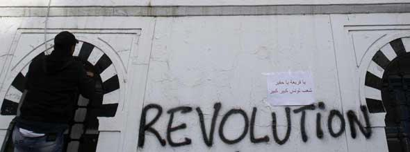 """Writing on the wall of Tunisia's prime minister, reading """"Revolution"""" (photo: AP)"""