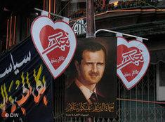 Posters of Assad in the new quarter of Damascus (photo: Kirsten Helberg/DW)