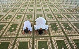 Men praying in a mosque in Ramallah (photo: AP)