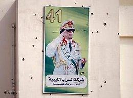 A portrait of Moammar Gadhafi on a wall covers by bullets marks is displayed on a building in the Abu Salim district, in Tripoli, Libya, Friday, Aug. 26, 2011 (photo: dapd)
