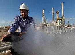 A Libyan oil worker works at a refinery inside the oil complex in Brega, east of Libya, on Saturday 26 February 2011 (photo: AP)