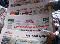 Regional print media at a newsstand in Cairo (photo: AP)