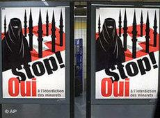 Poster by right-wing populists for the ban of minaretes in Switzerland (photo: AP)