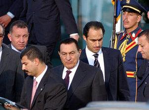 Egyptian President Hosni Mubarak, center, and his son Gamal, background right, leaves the conference center at the Red sea resort city of Sharm el-Sheik, Egypt, 8 February 2005 (photo: AP)