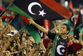 Rebels in Tripoli celebrate the end of the Gaddafi regime (photo: AP)