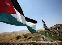 Jordanian and Israeli flags over the River Jordan (photo: AP)
