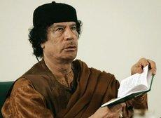 Muammar al-Gaddafi with the 'Green Book' (photo: AP)
