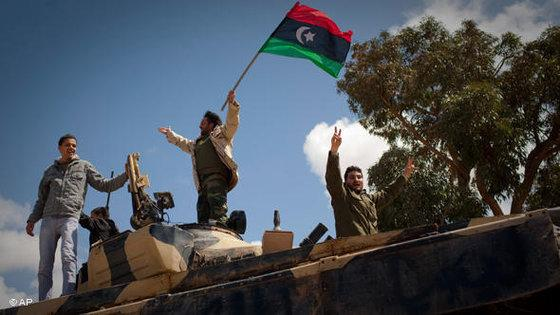Libyan rebels celebrate after taking Benghazi in March 2011 (photo: AP)