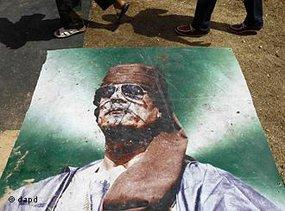 Battered poster of Gaddafi on the streets of Tripoli (photo: dapd)