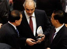 The Syrian Ambassador to the United Nations, Bashar Ja'afari (centre), speaks to the Chinese Ambassador, Li Baodong (photo: AP)
