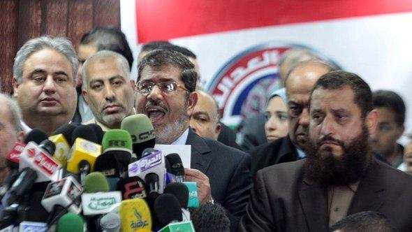 The president of the Muslim Brotherhood's Freedom and Justice Party in Egypt, Mohammed Morsy, speaking after his party's election victory (photo: dpa)