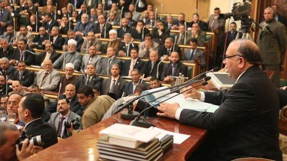 Mohamed Saad al-Katatni of the Muslim Brotherhood speaks to other members of parliament during the first Egyptian parliament session, after the revolution that ousted former President Hosni Mubarak, in Cairo January 23, 2012 (photo: Reuters)