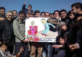 Syrian protestors hold up a drawing of Putin and Assad (photo: AP)