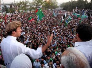 Pakistani cricket legend-turned politician Imran Khan, center wearing cap, addresses the crowd during a rally against the U.S. drone strikes in Pakistani tribal areas, Saturday, 23 April 2011, in Peshawar, Pakistan (photo: AP)