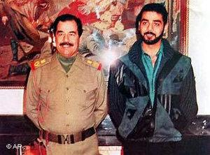 Saddam Hussein and his son Odari in 1990 (photo: AP)