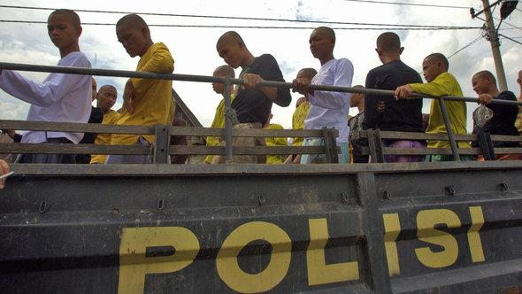 Arrested Indonesian punks are loaded onto a police truck (photo: EPA/HOTLI SIMANJUNTAK)