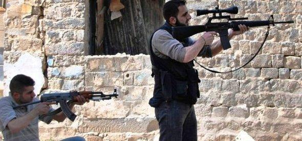 Free Syrian Army combattans in Homs (photo: AP/dapd)