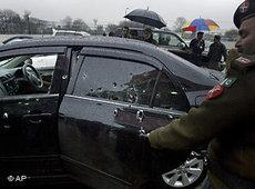 Police examine the damaged car of Pakistan's government minister for religious minorities, Shahbaz Bhatti, who was assassinated in March 2011 (photo: AP)