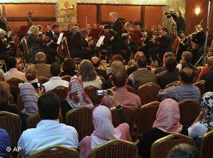 Israeli Maestro Daniel Barenboim, top right, UN Messenger of Peace, conducts the Orchestra for Gaza, a mixed orchestra of European musicians, during concert at the Al Mathaf Cultural House in Gaza City, Tuesday, 3 May 2011 (photo: AP)