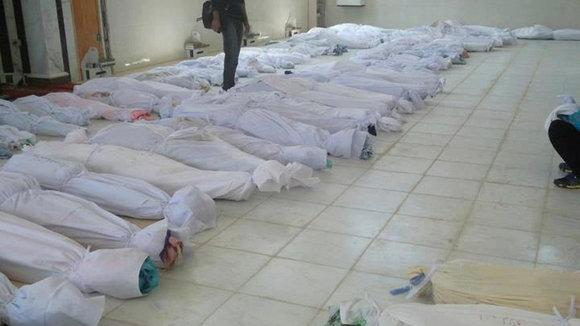 Victims of the Houla massacre lie on the ground of a mosque, May 26, 2012 (photo: Reuters)