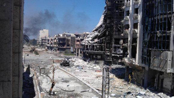 Damaged buildings in Homs in April 2012 (photo: Reuters)