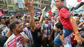 Supporters of Mohammed Morsi on 24 June in Cairo (photo: dpa)