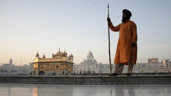 A Sikh standing in front of the temple in Amritsar (photo: AP)