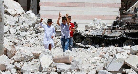 Hope for a military breakthrough soon: For most of the residents of Azaz and other villages and towns in rebel territory, it goes without saying that the insurgents will win. With or without new weapons. Pictured: children playing on the rubble in front of a destroyed mosque