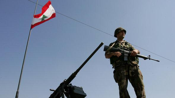 A Libyan soldier standing guard at a frontier post to Syria (photo: AP)