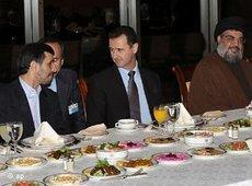 President Ahmadinejad of Iran (left), President Bashar al-Assad of Syria (centre) and Hezbollah leader Sheikh Hassan Nasrallah (right) during an official dinner in Syria, February 2010 (photo: AP)