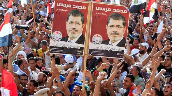 A crowd celebrating Mohammed Mursi's election as Egyptian president (photo: Reuters)